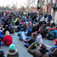 Crowd sitting in protest in Boston