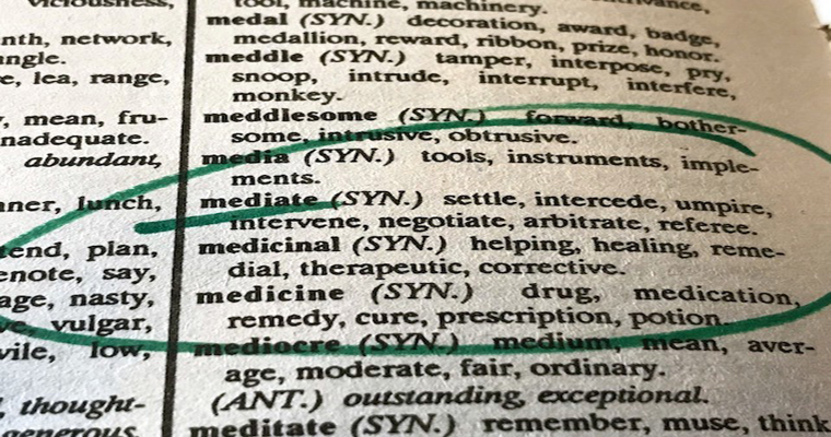 dictionary page showing the meaning of the word mediate