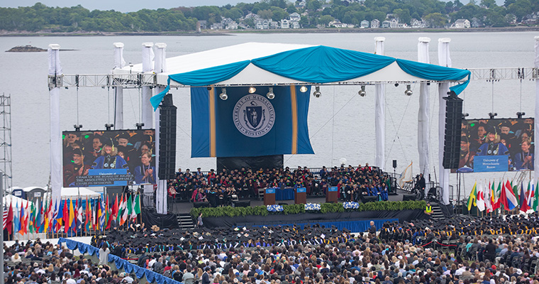 Overview shot of commencement with ocean in the background