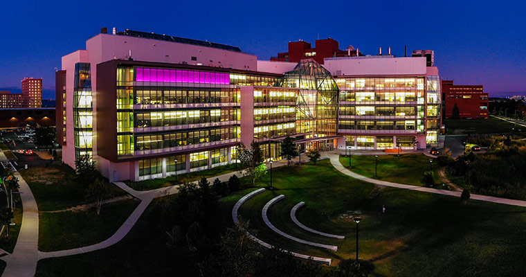 The Integrated Sciences Complex, lit up at night